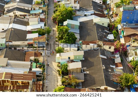 SAIGON, VIETNAM - NOVEMBER 16, 2014. An alley view from top in sunset, Saigon, Vietnam. Ho Chi Minh city (or Saigon) is the biggest city in Vietnam. - stock photo
