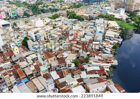 SAIGON, VIETNAM - OCTOBER 15, 2014. Colorful squatter shacks and houses in a Slum Urban Area in Ho Chi Minh City, Vietnam. Ho Chi Minh city (or Saigon) is the biggest city in Vietnam. - stock photo