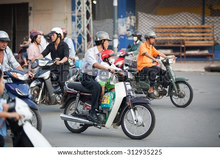 Saigon, Vietnam-October 16.The streets of Saigon(Ho Chi Min City) are crowded with scooters, motorbikes and bicycles, October 16, 2009. With 9 million people, it is the most populous city  in Vietnam - stock photo