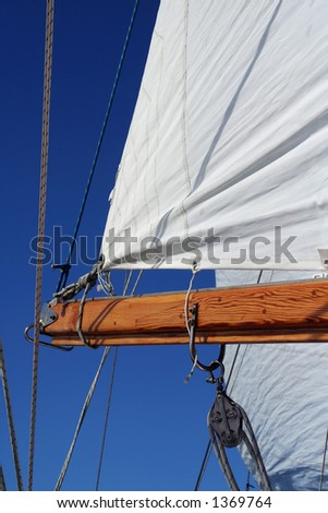 Sail and boom, portrait  view - stock photo