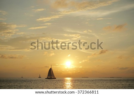 Sail and sunset in Gulf of Mexican. Key West, Florida, US - stock photo
