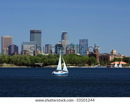 Sail boat and downtown Minneapolis at summer - stock photo