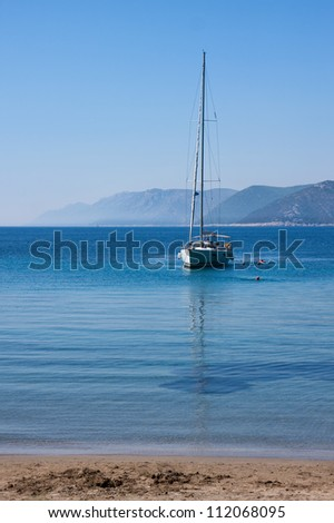 Sail boat and people in sea near Dubrovnik, Croatia - stock photo