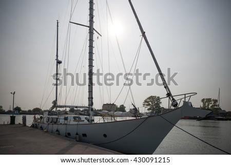 sail boat in harbor - stock photo