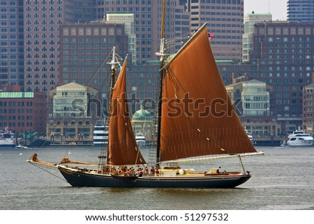 Sail boat in modern harbor - stock photo