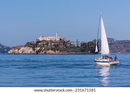 Sail Boat on San Francisco Bay And Alcatraz Island - stock photo
