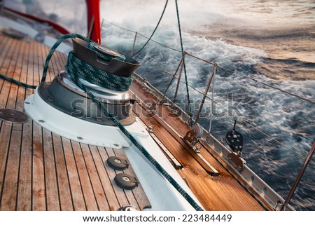sail boat under the storm, detail on the winch - stock photo