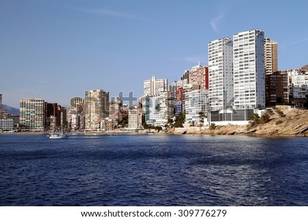 Sail boats anchored in the beach of Benidorm city - stock photo