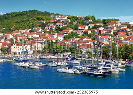 Sail boats anchored near Venetian old town by the Adriatic sea, Trogir, Croatia - stock photo