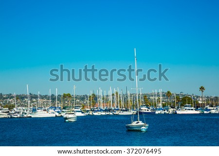 Sail boats in a harbor during a sunny day - stock photo