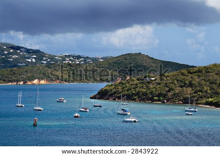 Sail Boats in St. Thomas Harbor with a Storm - stock photo