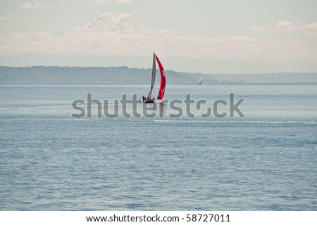Sail boats racing in the sea in a sunny spring day