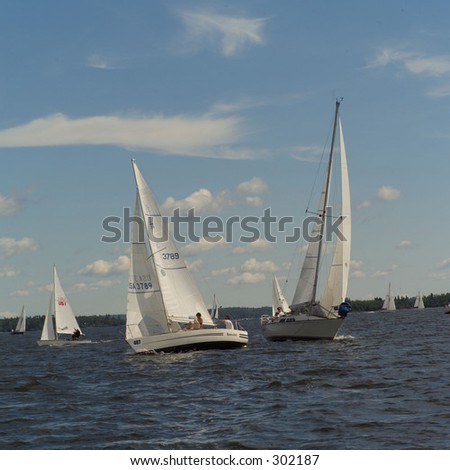 Sail boats sailing in a lake,
