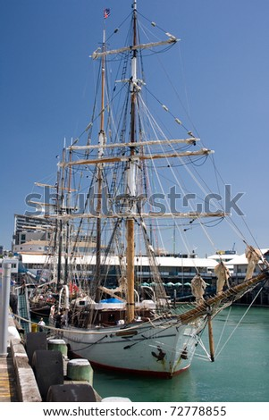 Sail ship rests in Auckland harbour - stock photo