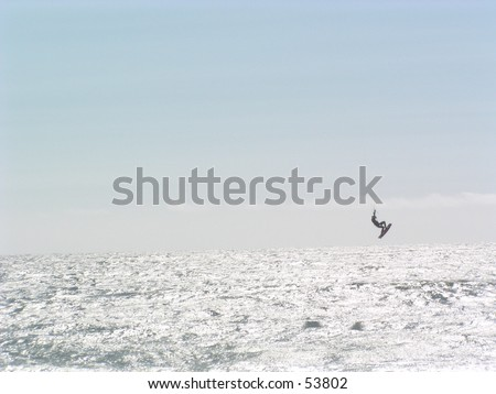 Sail surfer in a mid air trick