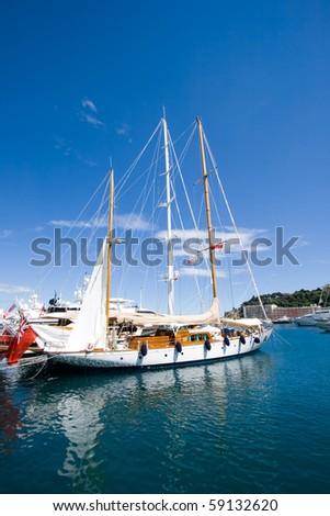 Sail yacht in the Monte Carlo harbour. Monaco - stock photo