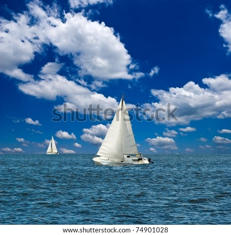 sail yacht regatta in a sea - stock photo
