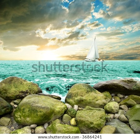 sail yacht swimming on a sea in the evening - stock photo