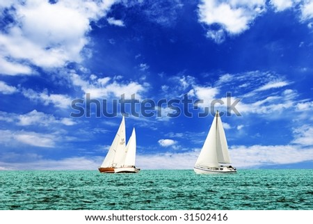 sail yachts in the sea - stock photo