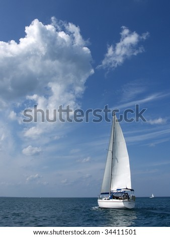 Sailboat against a beautiful skyscape on Lake Huron. - stock photo