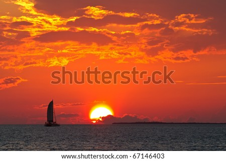 Sailboat against a beautiful sunset - stock photo