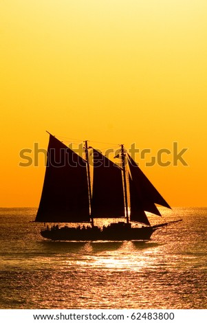 Sailboat against a beautiful sunset in Key West - stock photo