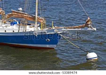 Sailboat anchored in Boston Harbor in Boston, Massachusetts - stock photo
