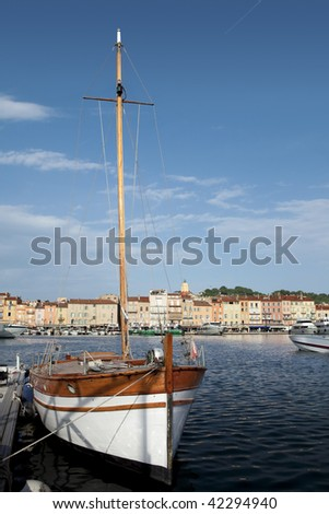 Sailboat anchored in the harbor of Saint Tropez. - stock photo