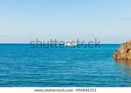 Sailboat and dingy at sea