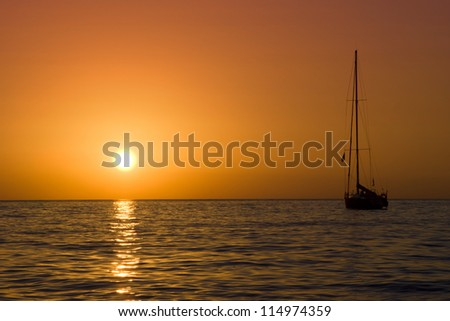 sailboat and sunset in the sea