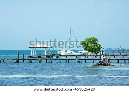 Sailboat at a pier off the beach on Caye Caulker, Belize