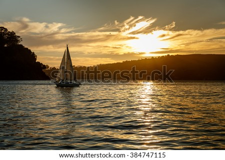 Sailboat at sunset in San Francisco Bay