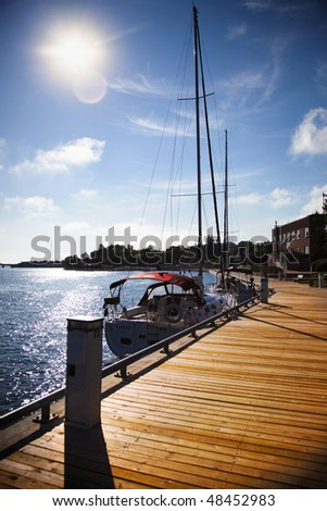 Sailboat At the Dock On a Sunny Day - stock photo