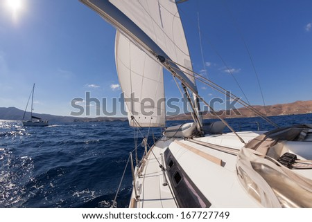 Sailboat crop during the regatta near greek islands  - stock photo