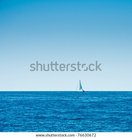 sailboat cruising vast seas - stock photo