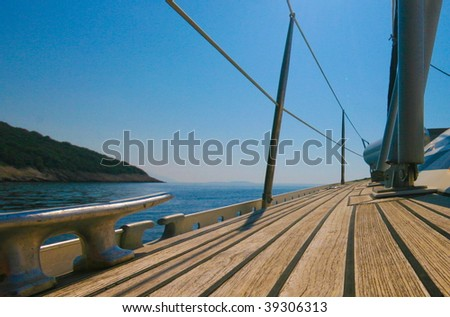 Sailboat deck with sky - stock photo