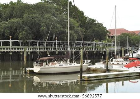 Sailboat docked in Shelter Cove Marina on Hilton Head Island, South Carolina. - stock photo