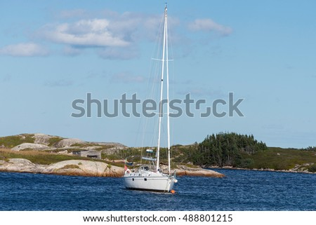 Sailboat in a quiet cove in Newfoundland