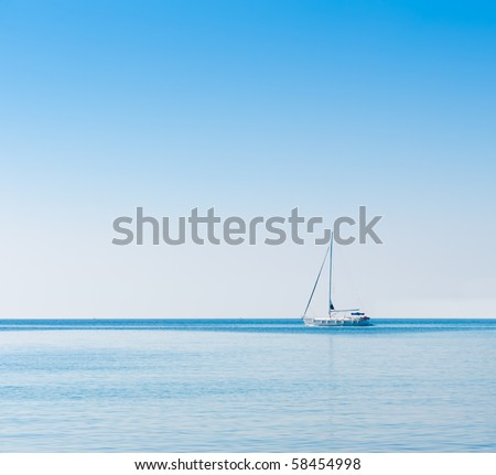 Sailboat in Adriatic sea. Blue sky over water horizon. Copyspace background - stock photo