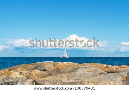 Sailboat in archipelago - stock photo