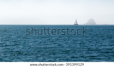 Sailboat in Ocean in front of Foggy Island House at Newport, Rhode Island