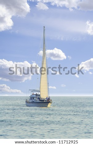Sailboat in sailing on wide open ocean