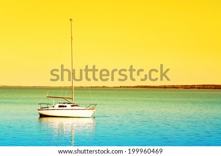 Sailboat in sunrise at Lake Balaton, Hungary - stock photo
