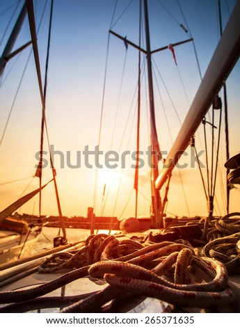 Sailboat in sunset light, sail yacht detail, yachting sport, adventure in the sea, summer holidays, luxury water transport - stock photo