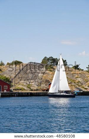 Sailboat in the swedish West coast archipelago - stock photo