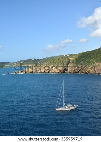 Sailboat near the coast of St Thomas US Virgin Islands - stock photo