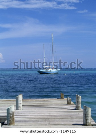 sailboat off the coast of belize - stock photo