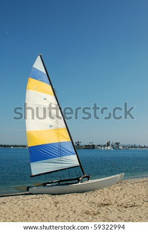 Sailboat on beach; Mission Bay; San Diego, California - stock photo