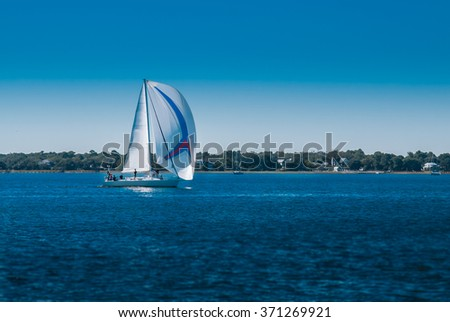 Sailboat on Blue Water - stock photo