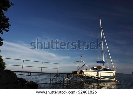 Sailboat on landing-stage at Lake Balaton in summer - stock photo